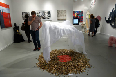 CURATOR KIM LUTTRELL AT THE SHOW IN STUDIO 34 GALLERY